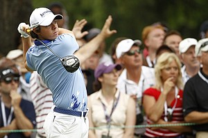 Rory McIlory, of Northern Ireland, tees off on the third hole during the final round of the U.S. Open Championship golf tournament in Bethesda, Md., Sunday, June 19, 2011.
