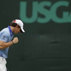 Rory McIlroy, of Northern Ireland reacts to his putt on the fifth hole during the final round of the U.S. Open Championship golf tournament in Bethesda, Md., Sunday, June 19, 2011.