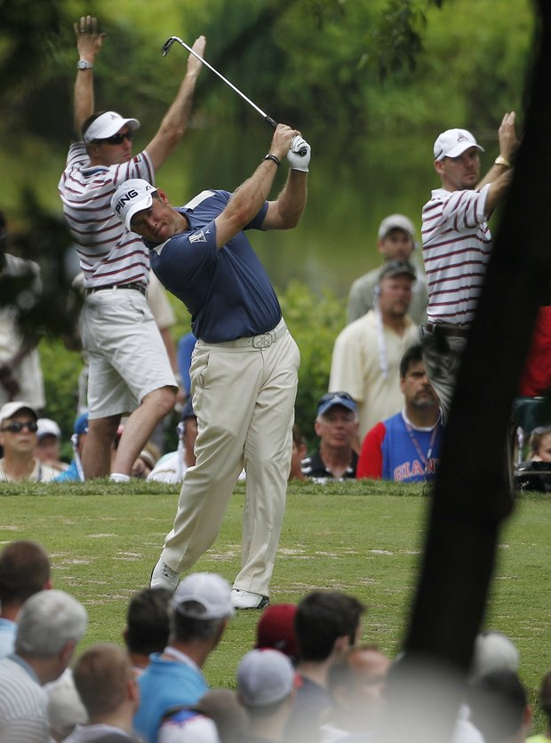 Lee Westwood, of England, tees off on the seventh hole during the final round of the U.S. Open Championship golf tournament in Bethesda, Md., Sunday, June 19, 2011.