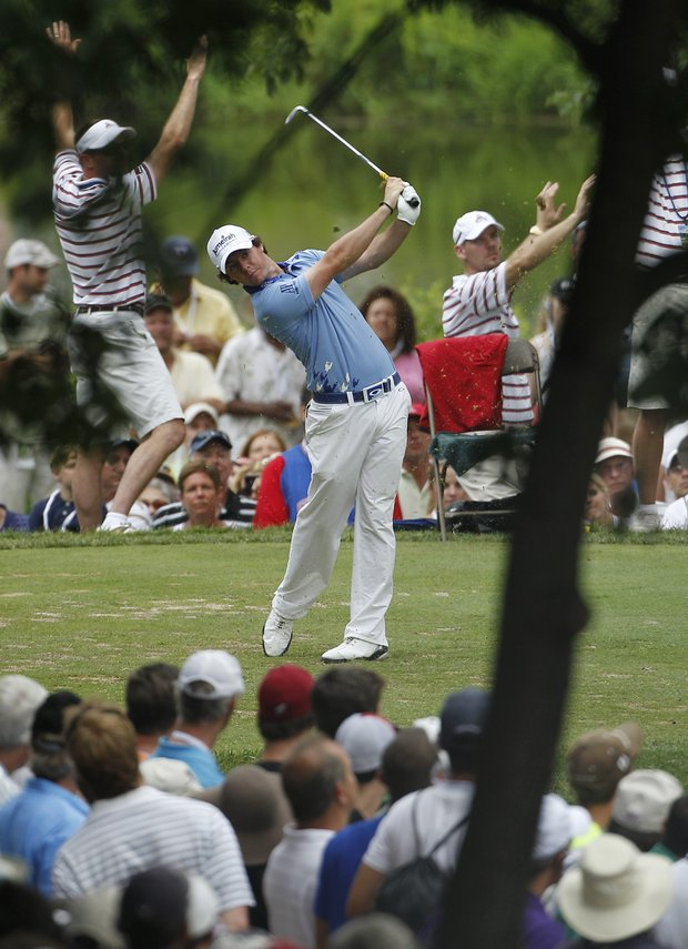 Rory McIlroy, of Northern Ireland, tees off on the seventh hole during the final round of the U.S. Open Championship golf tournament in Bethesda, Md., Sunday, June 19, 2011.