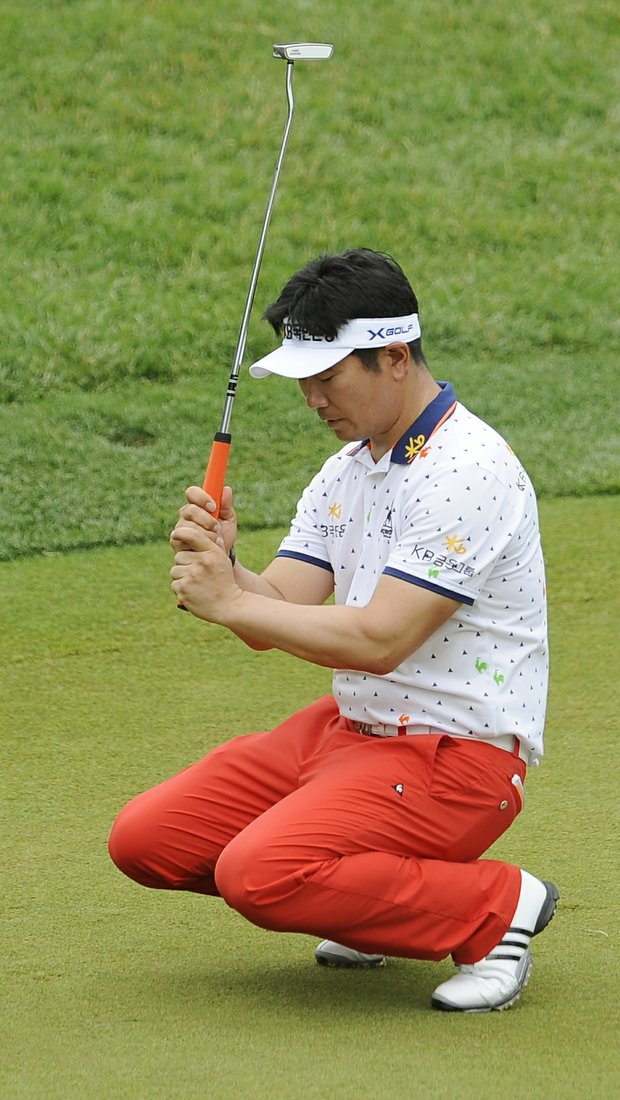 Y. E. Yang, of South Korea, reacts to his putt on the seventh green during the final round of the U.S. Open Championship golf tournament in Bethesda, Md., Sunday, June 19, 2011.
