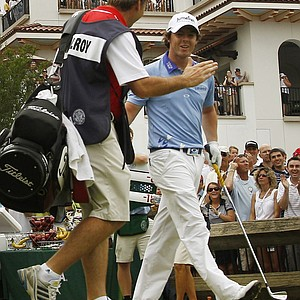 Rory McIlroy, of Northern Ireland, receives a high five from his caddie J.P. Fitzgerald, after hitting his drive from the 10th tee during the final round of the U.S. Open Championship golf tournament in Bethesda, Md., Sunday, June 19, 2011.