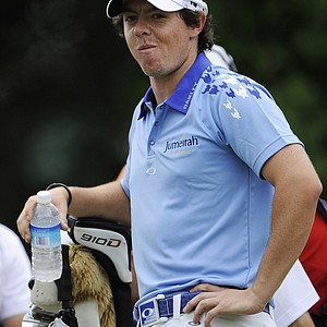 Rory McIlroy, of Northern Ireland, waits to hit on the 10th tee during the final round of the U.S. Open Championship golf tournament in Bethesda, Md., Sunday, June 19, 2011.
