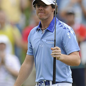 Rory McIlroy, of Northern Ireland, waves his putter at the gallery on 10th hole during the final round of the U.S. Open Championship golf tournament in Bethesda, Md., Sunday, June 19, 2011.