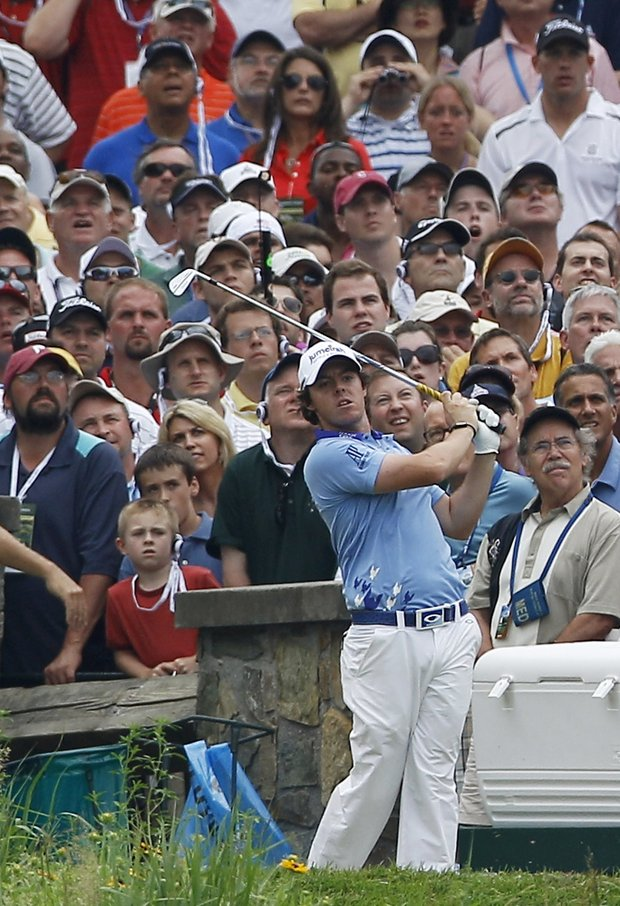 Rory McIlroy, of Northern Ireland, watches his drive from the tenth tee during the final round of the U.S. Open Championship golf tournament in Bethesda, Md., Sunday, June 19, 2011.