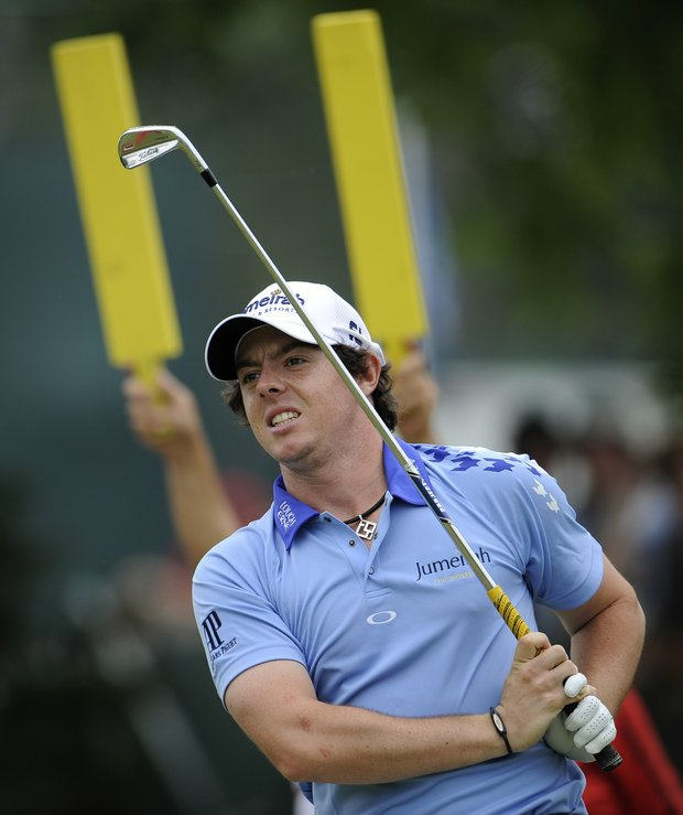 Rory McIlroy, of Northern Ireland, reacts to his drive from the 10th tee during the final round of the U.S. Open Championship golf tournament in Bethesda, Md., Sunday, June 19, 2011.