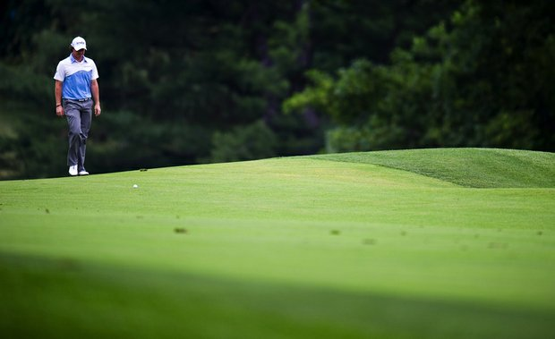 Rory McIlroy approaches his ball on the 15th hole during the third round of the 111th U.S. Open at Congressional Country Club.