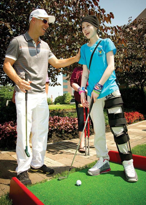PGA Tour player Ben Crane and patient Sydney share a few laughs.