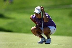Yani Tseng, defending champion, looks over her putt at No. 7 during the first round of the Kraft Nabisco Championship.