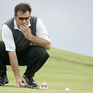 Nick Faldo of England looks at his putt on the 4th green during his first round at the British Senior Open golf championships at Muirfield golf course, Gullane, Scotland, Thursday July 26, 2007.
