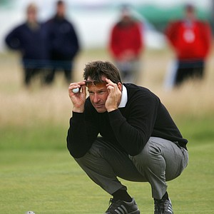 Nick Faldo of England looks at his putt on the 1st green during his final round at the British Senior Open golf championships at Muirfield golf course, Gullane, Scotland, Sunday July 29, 2007.