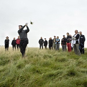 Golfer Nick Faldo plays out of the rough on the first hole during the first-ever match played at Ledreborg Palace Golf outside Copenhagen, Denmark, Sunday, Sept. 23, 2007. Faldo has designed the course and attended the inauguration by playing in a fourball.