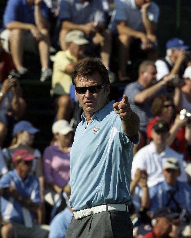 Europe team captain Nick Faldo gives directions to his players on the first tee during their practice round for the Ryder Cup at the Valhalla Golf Club, in Louisville, Ky., Thursday, Sept. 18, 2008.