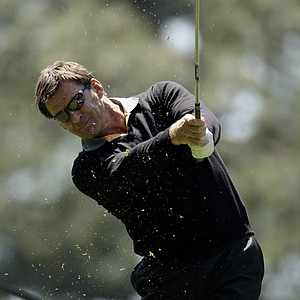 Former Masters' champion Nick Faldo tees off on the first hole during the Par 3 contest before the Masters golf tournament at the Augusta National Golf Club in Augusta, Ga., Wednesday, April 8, 2009.