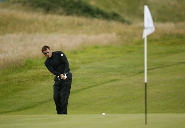 England's Nick Faldo plays onto the 17th green during a practice round for the British Open Golf Championship at Turnberry Golf Course, Scotland, Sunday, July, 12, 2009.