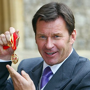"English golfer Nick Faldo poses with his insignia after being knighted by Britain's Queen Elizabeth II during a ceremony at Windsor Castle, England, Tuesday Nov. 10, 2009. Faldo says he ""had dreams as a young boy of being a golfer and winning tournaments, but you don't dream of this."" The two-time European Order of Merit winner won three Masters and three British Open titles and is just the second professional golfer to be knighted after Henry Cotton in 1988."