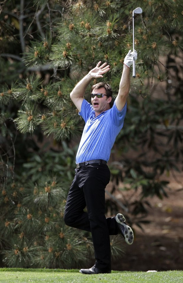 Nick Faldo of England reacts to his tee shot on the thrid hole during the par-3 tournament at the Masters golf tournament in Augusta, Ga., Wednesday, April 7, 2010.