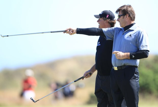 England's Nick Faldo, right, gestures with his club as he talks with playing partner Phil Mickelson of the U.S. during a practice round on the Old Course at St. Andrews, Scotland, Tuesday, July 13, 2010. The British Open golf tournament begins at St. Andrews on Thursday July 15.