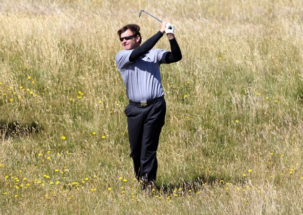 England's Nick Faldo plays out of the rough on the 17th hole during a practice round on the Old Course at St. Andrews, Scotland, Tuesday, July 13, 2010. The British Open golf tournament begins at St. Andrews on Thursday July 15.