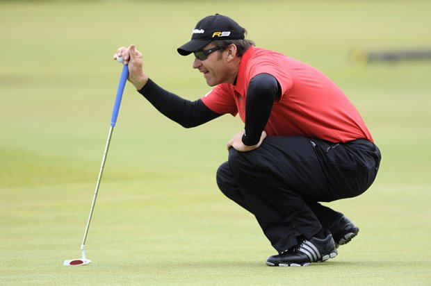 England's Sir Nick Faldo lines up a shot during round one of The Open Championship 2010 at St Andrews.