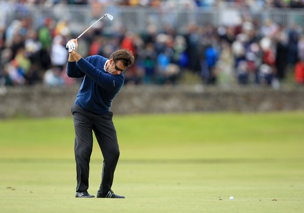 England's Nick Faldo practices his swing before hitting his second shot on the first fairway during his second round of the British Open Golf Championship on the Old Course at St. Andrews, Scotland, Friday, July 16, 2010.