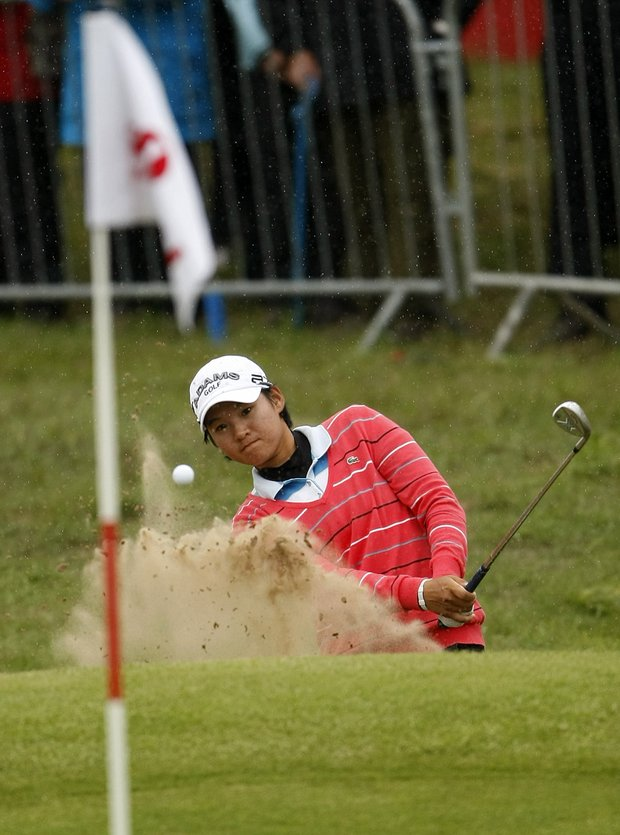Taiwan's Yani Tseng plays out of a bunker on the eighteenth hole during the second round of the Women's British Open, at Royal Birkdale Golf Club, Southport, England, Friday, July 30, 2010.
