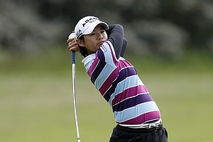 Taiwan's Yani Tseng plays an approach shot on the first hole during the final round of the women's British Open, at Royal Birkdale Golf Club, Southport, England, Sunday Aug. 1, 2010.