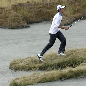 Patrick Cantlay scouts a bunker shot on the firth hole during a semifinal match of the U.S. Amateur golf tournament, Saturday, Aug. 28, 2010, at Chambers Bay in University Place, Wash. Cantlay was defeated by Peter Uihlein Saturday, and Uihlein will face David Chung in the final match Sunday.