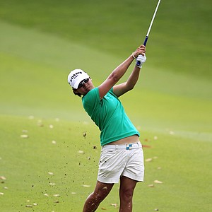 Yani Tseng of Taiwan hits the ball off the fairway on the 7th hole during the second round of the HSBC Women's Champions Golf tournament, Friday Feb. 25, 2011 in Singapore.