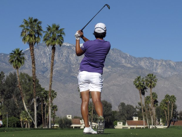 Yani Tseng of Taiwan,watchers her tee shot on the fifth hole during the first round of the LPGA Kraft Nabisco Championship golf tournament in Rancho Mirage, Calif., Thursday, March 31, 2011.