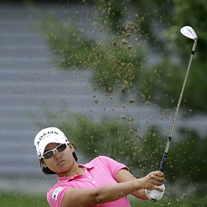 Yani Tseng of Taipei, Taiwan hits the ball out of the sand onto first green during the LPGA State Farm Classic golf tournament Sunday, June 12, 2011 in Springfield, Ill.
