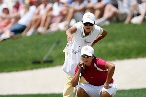 Yani Tseng and her caddy Sherry Lin read a putt during the LPGA Ginn Open at Reunion Resort, Sunday, April 20, 2008.