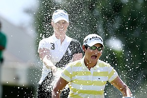 Yani Tseng is sprayed with champagne by Morgan Pressel after winning the Kraft Nabisco Championship.