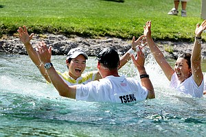 Yani Tseng, the 2010 Kraft Nabisco Champion celebrates in Poppies Pond with her caddie and friends and family.