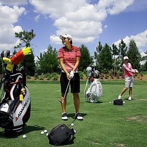 Yani Tseng with fellow LPGA golfer, Na Yeon Choi at the driving range at Lake Nona Golf and Country Club.