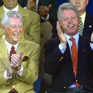 "President Clinton laughs with U.S. team captain Ken Venturi, left, after International team captain Peter Thomson called Clinton the ""World's No. 1 golfer"" during opening ceremonies for the President's Cup at Robert Trent Jones Golf Club on Wednesday, Oct. 18, 2000, in Gainesville, Va."