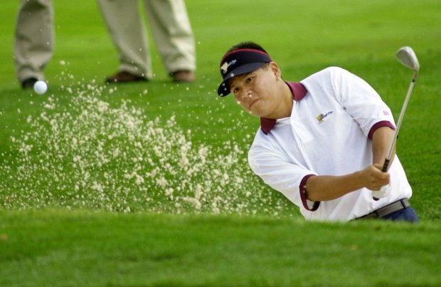 Notay Begay III of Albuquerque, N.M., hits from a bunker on the14th hole after his playing partner Tiger Woods hit into the trap during a practice round using the alternate shot format for the President's Cup at Robert Trent Jones Golf Club Wednesday, Oct. 18, 2000 in Gainesville, Va.