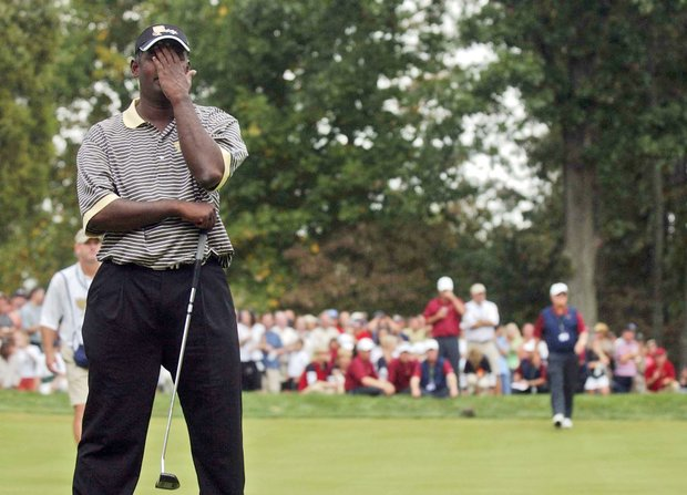 International team member Vijay Singh reacts to missing a putt on the 17th green during the final day of the President's Cup Sunday, Sept. 25, 2005 in Gainesville, Va. Vijay lost to American team member Fred Couples.