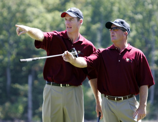 Jim Furyk, left, helps United States teammate Fred Funk on the sixth green during practice for the Presidents Cup Wednesday, Sept. 21, 2005, in Gainesville, Va.