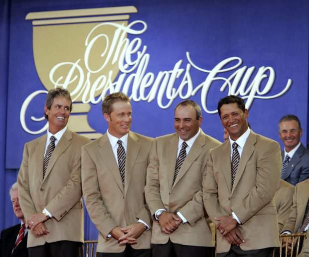 International team members, from left, assistant captain Ian Baker Finch, Stuart Appleby, of Australia, Angel Cabrera, of Argentina, and Michael Campbell, of New Zealand, are introduced during opening ceremonies for the 2005 Presidents Cup Thursday, Sept. 22, 2005, at the Robert Trent Jones Golf Club in Gainesville, Va.