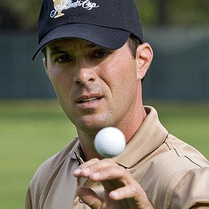 International Presidents Cup team member Mike Weir, from Canada, catches a ball from his caddie before the second practice round at the Royal Montreal Golf Club in Montreal Wednesday, Sept. 26, 2007.