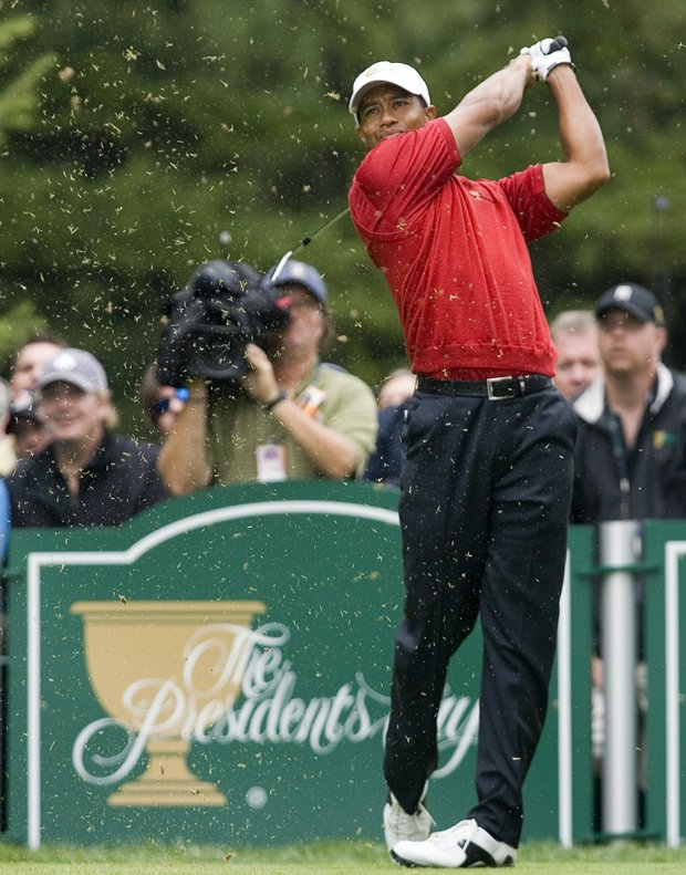 United States Presidents Cup team member Tiger Woods tees off on the fifth hole during the foursome matches at the Presidents Cup golf tournament Thursday, Sept. 27, 2007 in Montreal.