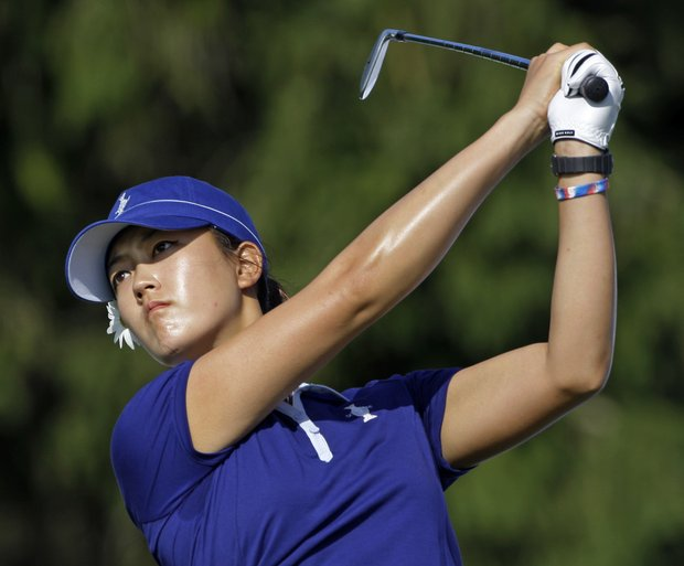 Team USA's Michelle Wie hits a drive on the third hole during a practice round for the Solheim Cup golf tournament Wednesday, Aug. 19, 2009, at Rich Harvest Farms in Sugar Grove, Ill.