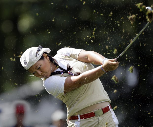 Team USA's Christina Kim hits a shot on the 13th hole during a practice round for the Solheim Cup golf tournament Thursday, Aug. 20, 2009, at Rich Harvest Farms in Sugar Grove, Ill.