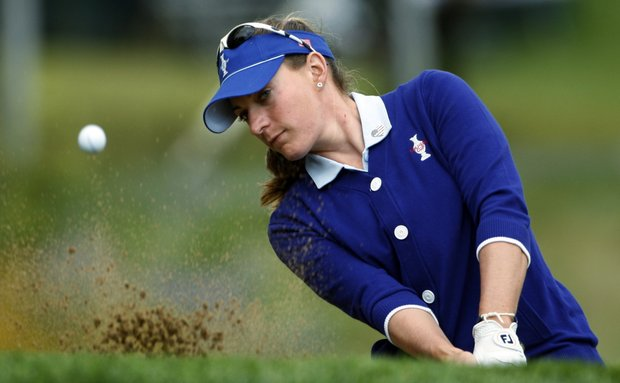 Team USA's Brittany Lang hits out of a bunker on the third hole during a four-ball match at the Solheim Cup golf tournament Friday, Aug. 21, 2009, at Rich Harvest Farms in Sugar Grove, Ill.