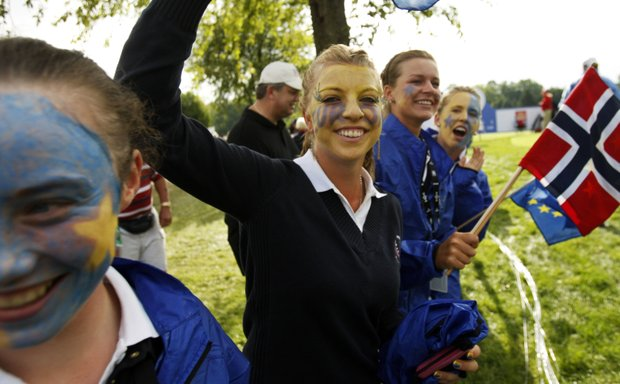 European fans cheer on players as they walk to the third hole during a four-ball match at the Solheim Cup golf tournament Friday, Aug. 21, 2009, at Rich Harvest Farms in Sugar Grove, Ill.