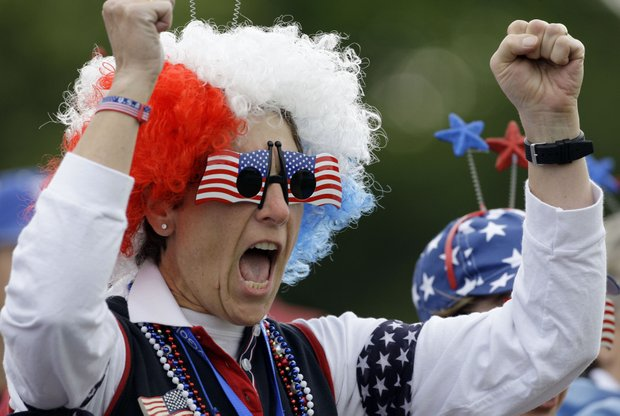 A USA fan reacts during a four-ball match at the Solheim Cup golf tournament Friday, Aug. 21, 2009, at Rich Harvest Farms in Sugar Grove, Ill.