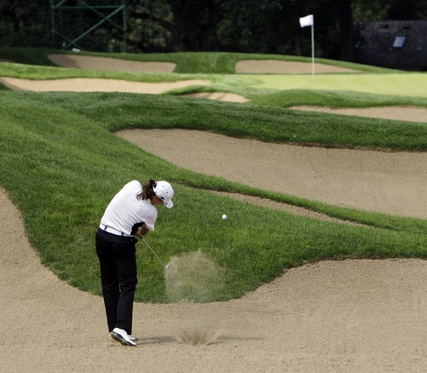 Team Europe's Sophie Gustafson of Sweden hits out of a bunker on the ninth hole during a four-ball match at the Solheim Cup golf tournament Friday, Aug. 21, 2009, at Rich Harvest Farms in Sugar Grove, Ill.