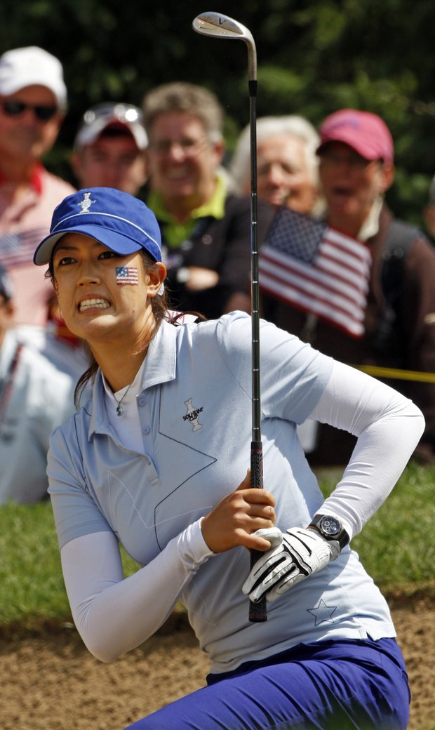 Team USA's Michelle Wie reacts to a bunker shot on the 14th hole during a four-ball match at the Solheim Cup golf tournament Friday, Aug. 21, 2009, at Rich Harvest Farms in Sugar Grove, Ill.