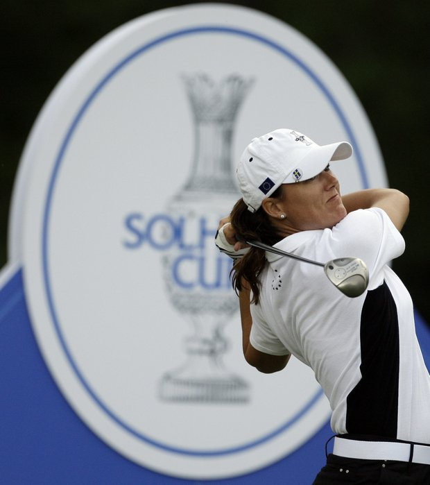 Team Europe's Sophie Gustafson of Sweden hits a drive on the 12th hole during a foursome match at the Solheim Cup golf tournament Friday, Aug. 21, 2009, at Rich Harvest Farms in Sugar Grove, Ill.